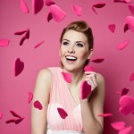 woman surrounded in heart petals